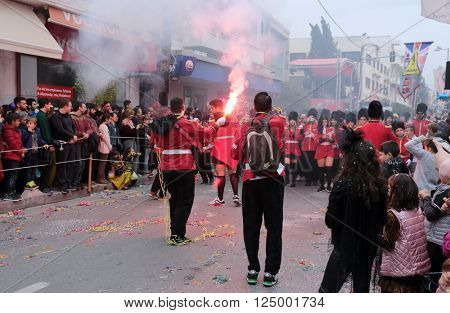 RETHYMNO, CRETE - MARCH 13, 2016: Revellers at the Carnival parade in the southern Greek island of Crete. The Rethymnon celebration is one of the largest  in the country.