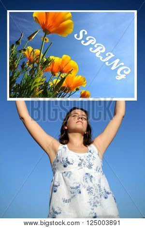 Young woman holding SPRING board