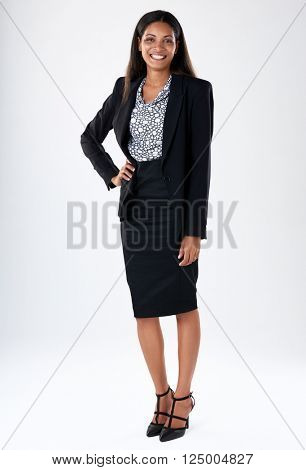 Confident asian businessperson smiling in studio, full length portrait