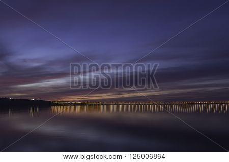Dramatic sunset over Volga River and Presidental Bridge , located in Ulyanovsk. Blue hour photo