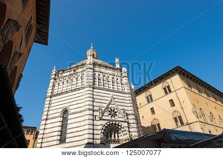 Baptistery of San Giovanni in corte or Ritondo (1303-1361) in Cathedral square (Piazza Duomo). Pistoia, Tuscany, Italy