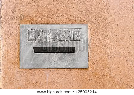 Detail of an Italian marble letterbox on a wall with text Lettere in italian language (Letters). Pistoia, Tuscany, Italy