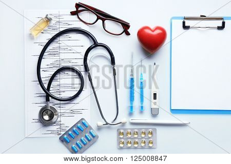 Doctor table with medicines and glasses, top view