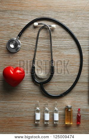 Doctor table with medicines and stethoscope, top view