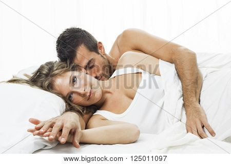 attractive woman and man together lying on the bed