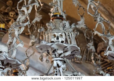 KUTNA HORA SLOVAKIA - JULY 8 2009: Sedlec Ossuary (aka Church of Bones) beneath the Cemetery Church of All Saints contains over 40000 skeletons whose bones are artistically arranged as decorations