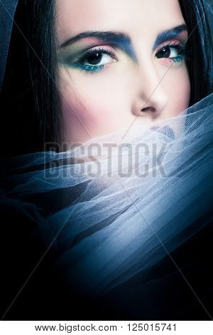young mysterious woman portrait with white veil