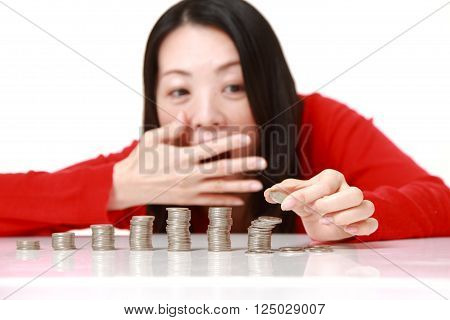 stack of coins  collapsed when woman put a coin