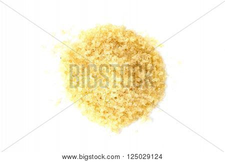 Pile of gelatin granules on white background