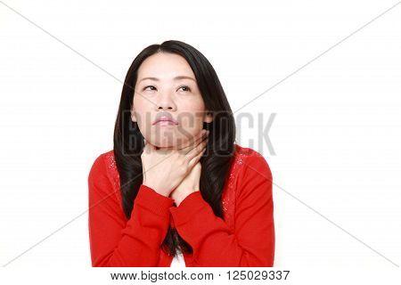 portrait of Japanese woman having throat pain