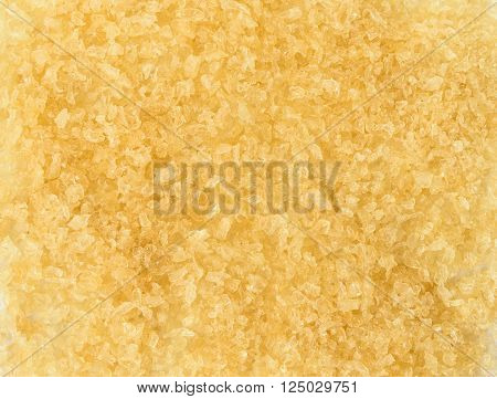 Yellow gelatin granules crystals. Close up background texture