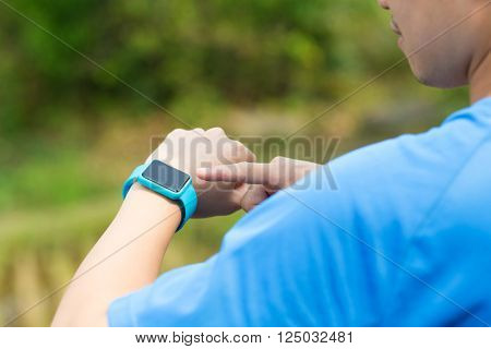 Man using msart watch at outdoor