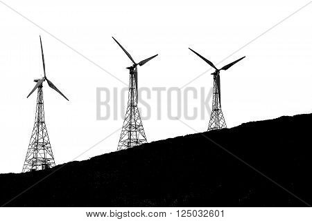 Silhouette of Wind turbine on hill black and white