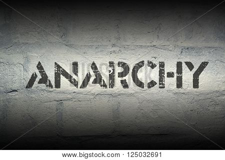 anarchy stencil print on the grunge white brick wall