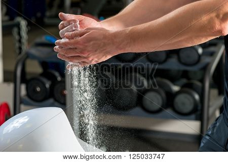 Talc In Male Hands In Gym Close Up