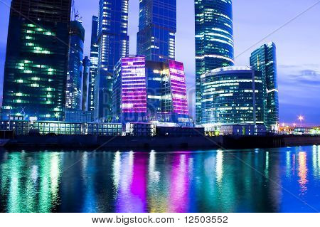 modern glass apartment blocks of skyscrapers at night