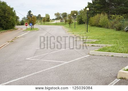 empty parking place arranged by white marking