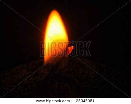 Yellow orange flame of traditional oil lamp used in Hindu temple.