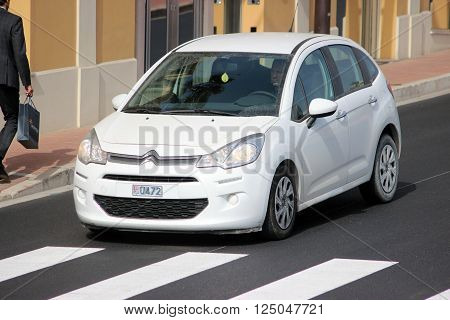 Monte-Carlo Monaco - April 6 2016: White Citroen C3 on Avenue d'Ostende in Monaco. Man Driving a French Car Citroen C3 in the South of France