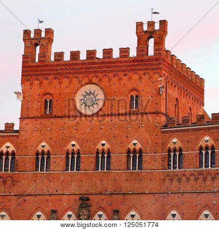 Campo Square with Public Building at sunset Siena Italy