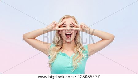emotions, expressions, positive gesture and people concept - smiling young woman or teenage girl showing peace hand sign with both hands over rose quartz and serenity gradient background