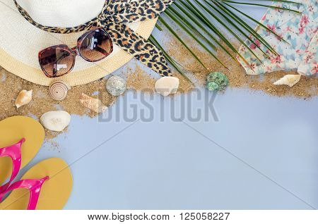 Summer accessories and costume on blue background