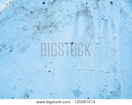 Close-up of blue aged paint on the wall. Old weathered painted wall surface. Grunge background with vintage paint