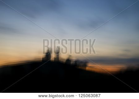 Landscape image of enchanting fairytale castle ruins during beautiful sunset with blur filter applied