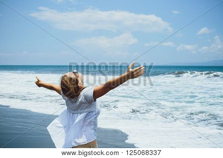 Smile Freedom And Happiness Woman On Beach. She Is Enjoying Serene Ocean Nature During Travel Holida