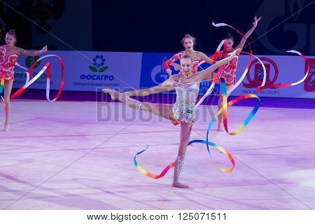 MOSCOW, RUSSIA - FEBRUARY 21, 2016: Unidentified dancers dance gymnastics team at the gala concert Grand Prix Moscow - 2016 in Moscow sport palace Luzhniki, Russia