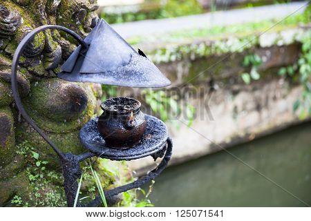 Burning oil lamp in Pura Saraswati Temple. Ubud Bali Indonesia.