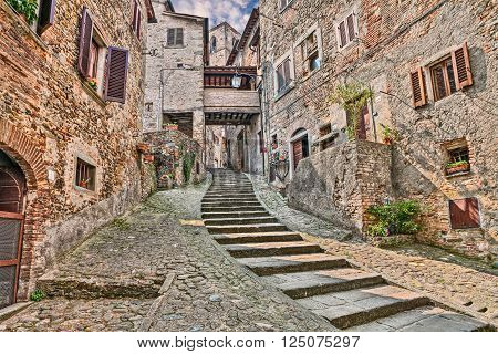 picturesque old narrow alley with staircase in the medieval village Anghiari, province of Arezzo, Tuscany, Italy