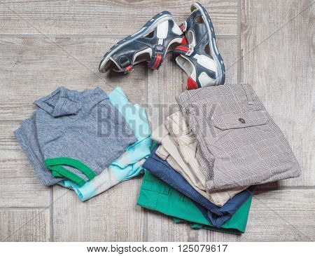 Photography of boy's casual outfits. Boy's casual outfits on wooden background