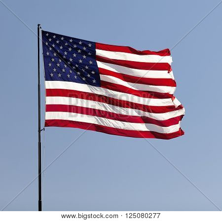 American Flag On Pole In The Wind Usa