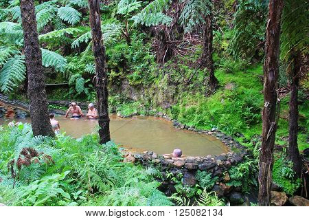 SAO MIGUEL ISLAND, AZORES, PORTUGAL - OCTOBER 2, 2015: People enjoy bath in natural thermal pools of Caldeira Velha on Sao Miguel island