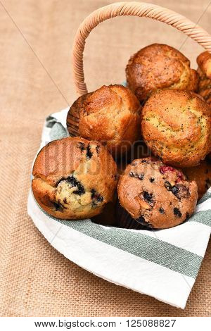 Basket of fresh baked muffins. Blueberry, Cranberry, Lemon Poppy Seed are among the varieties shown.