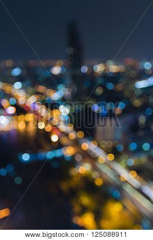 Night blurred bokeh light, city bridge cross river night time