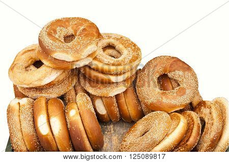 heap of fresh big bagels on a white background