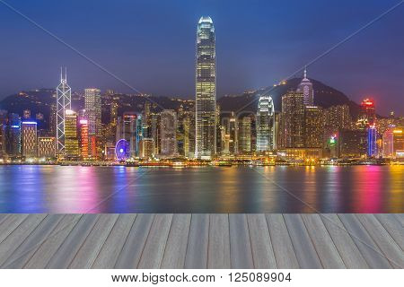 Opeing wooden floor, Hong Kong cityscape waterfront over Victoria harbor, twilight