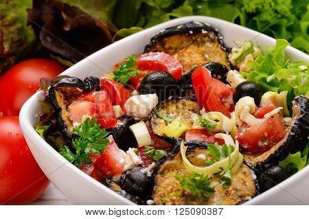 Summer vegetable salad with grrilled eggplants, tomatoes, feta and olives.