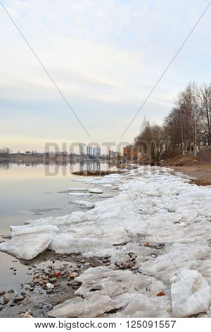 View of Neva River on the outskirts of St. Petersburg at sunny spring evening Russia.