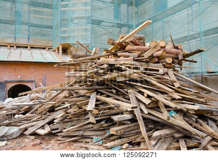pile of old broken rotting planks and logs
