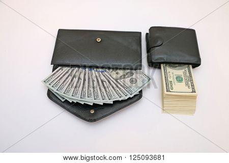 cash in two leather wallets women's men's