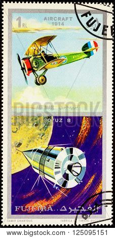 MOSCOW RUSSIA - APRIL 09 2016: A stamp printed in Fujeira shows Russian spacecraft Soyuz 8 and ancient aircraft (1914) series