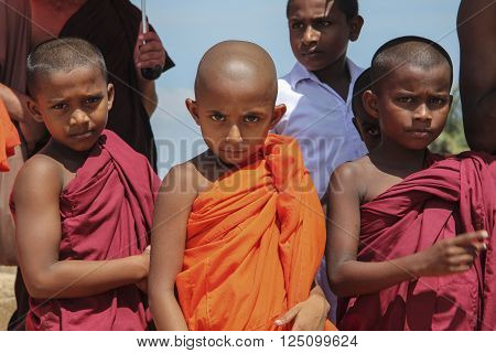 FORT GALLE, SRI LANKA, 01 MARCH 2014. FACES MONK BOYS .