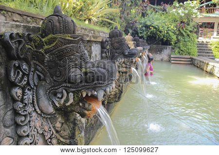 Hot holy springs in Bali Indonesia. Swimming pool for ritual bathing.