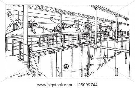 Overview of a series of five fermentation tanks, vintage engraved illustration. Industrial encyclopedia E.-O. Lami - 1875.
