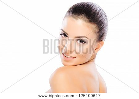 Head and shoulders portrait of beautiful model on white background.