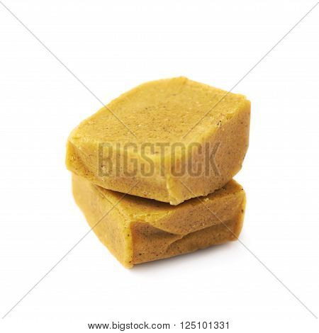 Two bouillon stock broth cubes, composition isolated over the white background