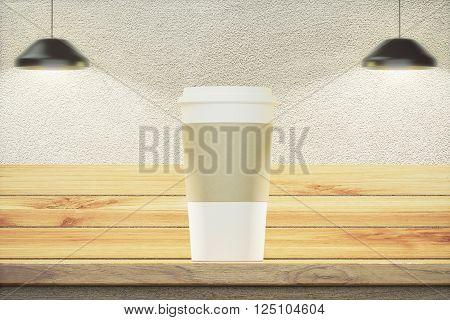 Frontview of wooden table with blank white coffee cup and two lamps. Mock up 3D Rendering